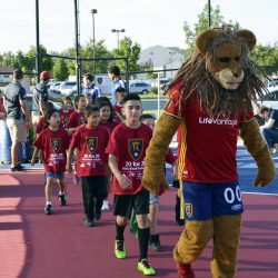 RSL mascot leading Granger students on to mini pitch