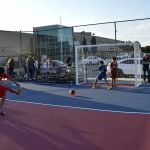 Granger Elementary students kicking soccer ball on new mini pitch