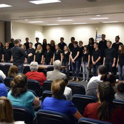 Cottonwood High Madrigals sing during board meeting