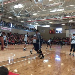 Utah Jazz players playing basketball at Granger High School