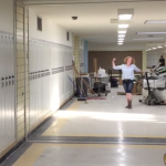 West Lake teacher moves a pallet down a hallway
