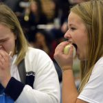 Hunter students eat raw onions