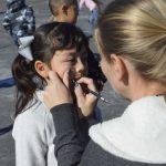 PTA volunteer paints mustache on West Kearns student