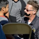 Police officer paints mustache on West Kearns student