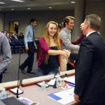 Academic All State recipients shake hands with board members