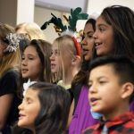 Whittier Elementary students sing during board meeting