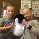 Hunter Elementary students hold up stuffed penguin