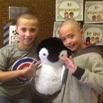Hunter Elementary students hold up stuffed penguin