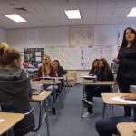 Granite Park Jr High teacher speaking to students in classroom
