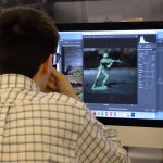 Student editing photo on computer