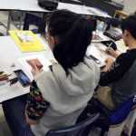 Students working with colored pencils
