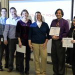 School employees accept awards in front of audience