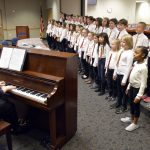 Magna Elementary student sing during board meeting