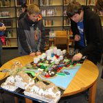 Judges assess prototype city created by junior high students