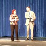 Teacher receives Excel Award in auditorium