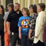 Hartvigsen teacher poses for photo with colleagues