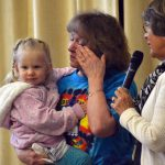 Hartvigsen teacher wipes tears as she holds toddler