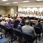 Calvin Smith students sing during board meeting