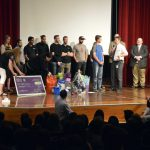 Bennion Jr High student and guests stand on stage