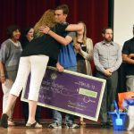 Bennion Jr High teacher hugs student on stage