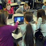 Rolling Meadows teacher and students work on laptop