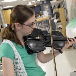 Granger High student plays custom violin in lab