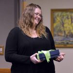 Sarah Wilson accepting a gift during board meeting