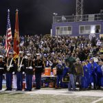 Marine Corps personnel in front of Cyprus High fans