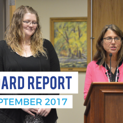 Teacher of the year being recognized at board meeting with text 'Board Report September 2017'