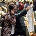 Olympus High student holds up a t-shirt