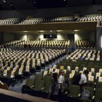 T-shirts draped on seats of Olympus High auditorium