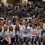 Olympus High student body pose with hand-designed shirts