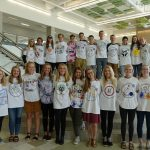 Olympus High students pose with hand-designed shirts
