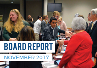 Athletes shaking hands with board members with text 'Board Report November 2017'