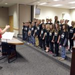 Rosecrest students sing during board meeting