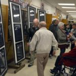 Visitors read memorial plaques inside Granite Park Jr High