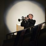 A bugle player inside Granite Park Jr High's auditorium