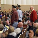 Veterans stand to be recognized at Granite Park Jr High