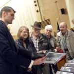Granite Park principal shows family members of fallen soldier information on the soldier's school records