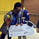 Taylorsville High student and mom holding giant check