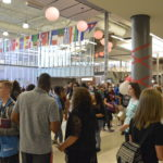 Students and teachers moving through Granger High commons area