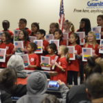 Moss Elementary students sing during board meeting