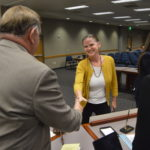 A PTA member shakes hands with a board member