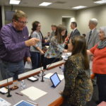 PTA members shake hands with board members