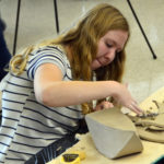 Student working on sculpture