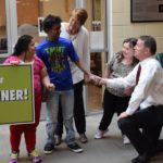 Superintendent shakes hands with Hartvigsen student