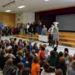 Crestview teacher given Excel Award during assembly