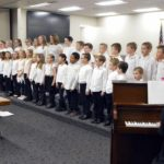 Calvin Smith choir performs at board meeting