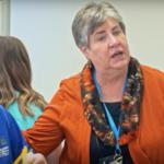 South Kearns principal talks with students