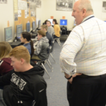 Olympus Jr principal talks with students at computers